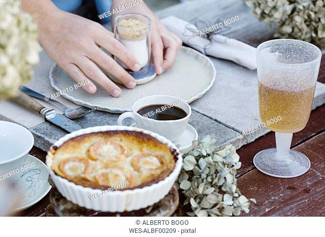 Italy, Italy, woman laying breakfast table, partial view