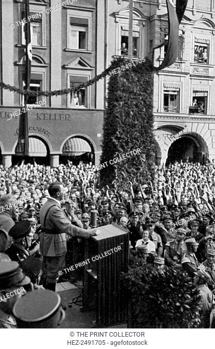 Celebrating the 15th anniversary of the formation of the Nazi Party, Rosenheim, Germany, 1935. German Nazi leader Adolf Hitler (1889-1945) making a speech to...