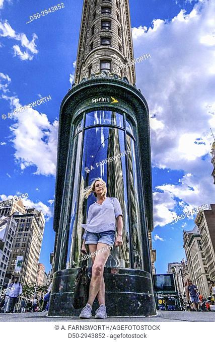 New York, New York, Manhattan, USA Flatiron Building and woman