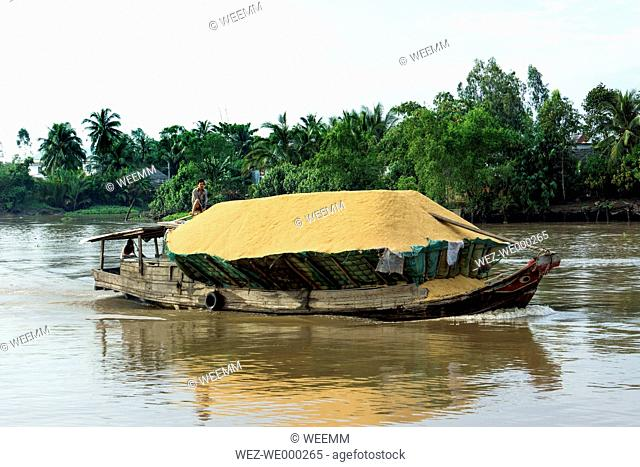 Vietnam, Nam Bo, Can Tho, shipping of rice at Mekong Delta