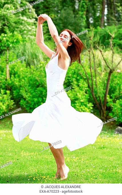 Woman dancing on flower meadow