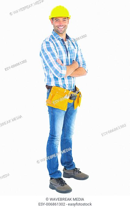 Portrait of manual worker standing arms crossed