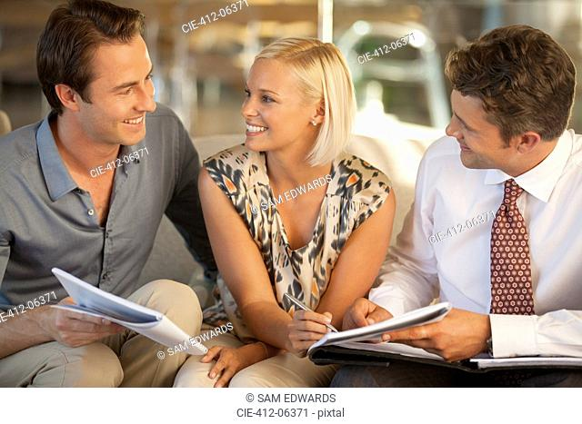 Business people talking on sofa