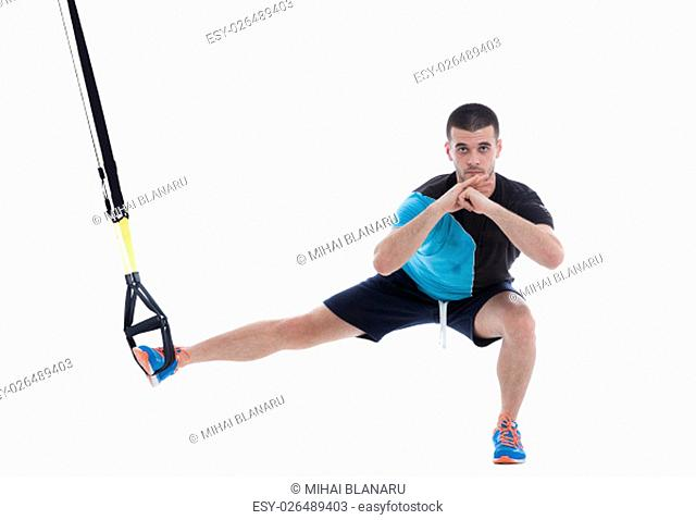 Athletic trainer on functional loops for training isolated on white background