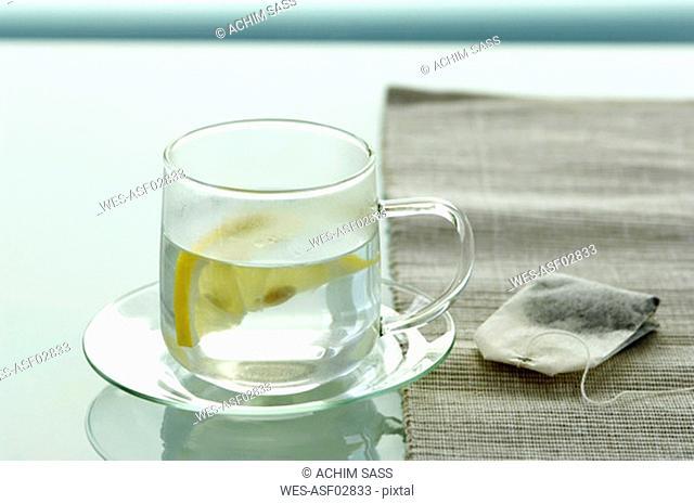 Teacup by tea bag, close-up