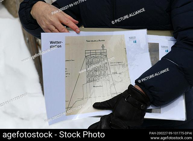27 February 2020, Bavaria, Grainau: Detlef Knipping from the Bavarian State Office for the Preservation of Historical Monuments holds old construction plans for...