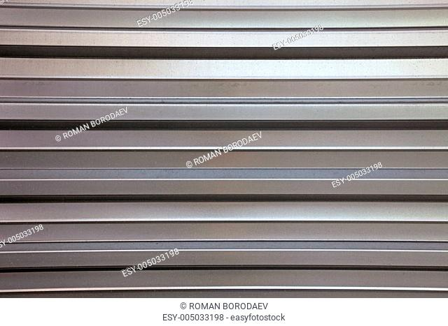 Abstract lined aluminium wall as backdrop or background