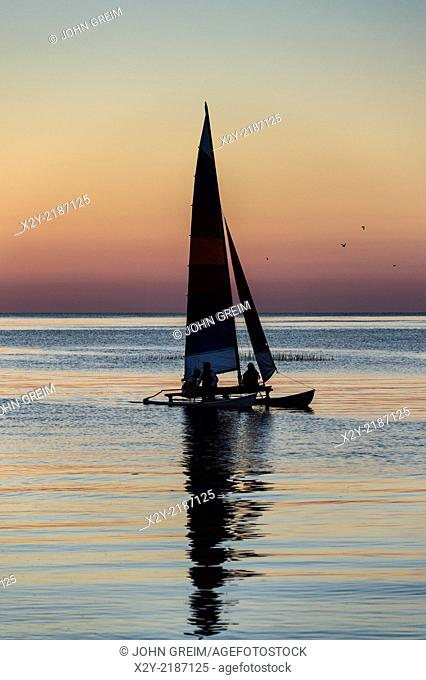 Sunset Sail boat on Cape Cod Bay, Massachusetts, USA