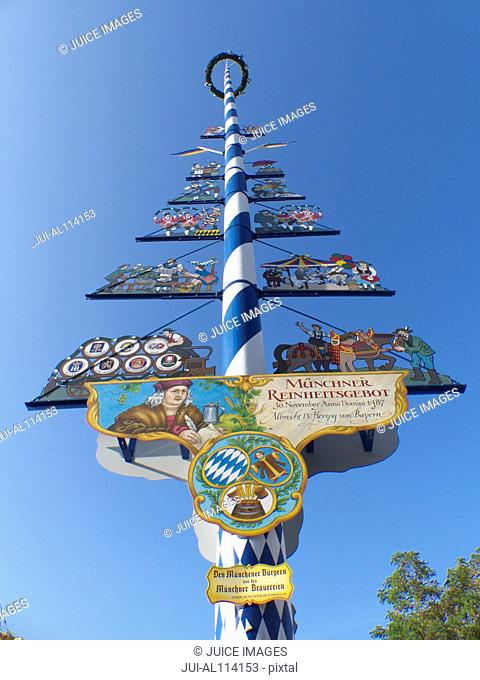 The Maypole in the centre of the Viktualienmarkt in Munich, Bavaria, Germany, Europe