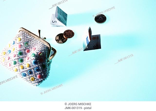 A purse, portemonnaie, with banknotes and coins