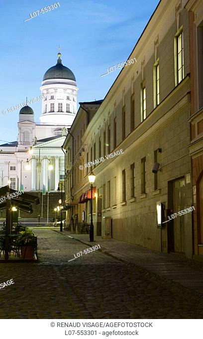 Cathedral and cobble stone street in old town at night. Helsinki. Finland