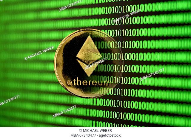 Symbolic image of digital currency, golden coin Ethereum