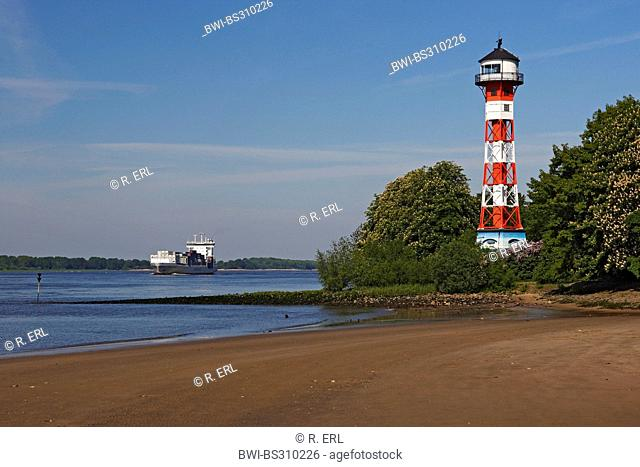 lighthouse of Wittenbergen and cargo ship, Germany, Elbe, Hamburg