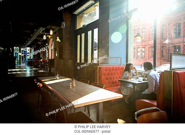 Couple sitting in restaurant booth