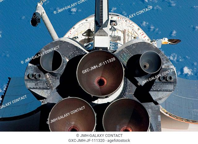 This view of the aft portion of the space shuttle Endeavour, including the three main engines, was provided by an Expedition 22 crew member during a survey of...