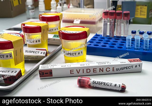 Various analyses of urine, saliva and blood of homicide suspects in crime lab, conceptual image