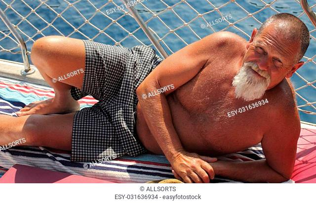 An englishman with a beard while on vacation during the summertime
