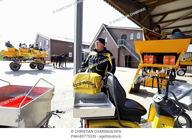 Mailman Michael Stobbe delivers the mail with his electric vehicle on Neuwerk island, Germany, 4 April 2017. For 20 years