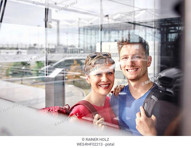 Portrait of smiling couple at the airport