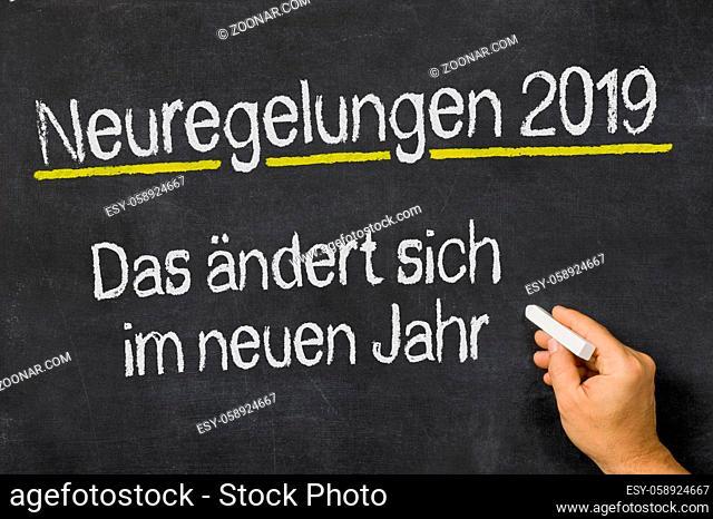 Neuregelungen 2019 written on a blackboard - Changes Coming in 2019 in german