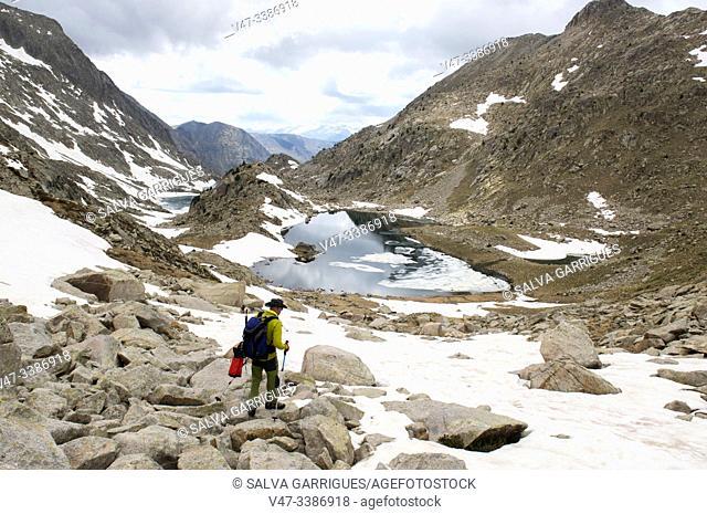 Mountaineer ascending to the peak of Vallibierna, Huesca, Aragon, Spain