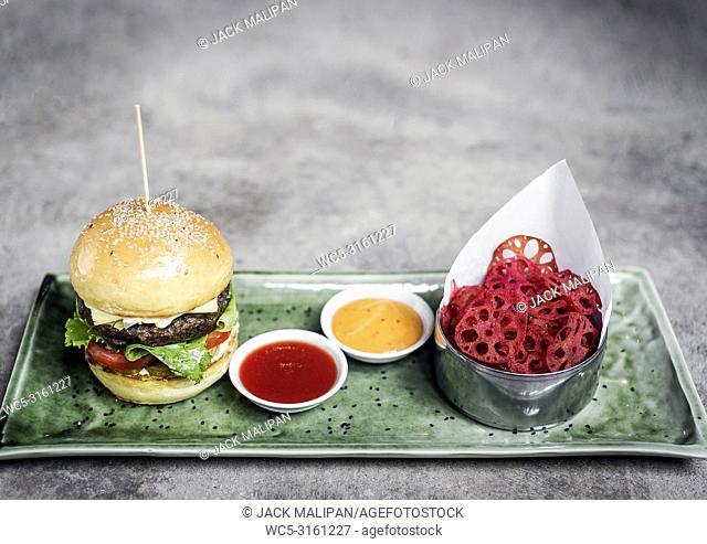 fusion asian beef burger set with lotus chips and wasabi mayonnaise