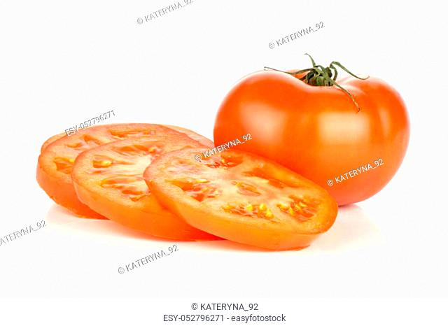Sliced red tomato isolated on white background one whole and three circle slices