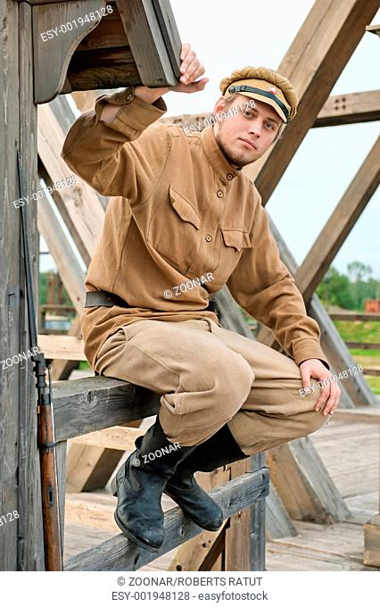 Retro style picture with soldier sitting next to the sentry