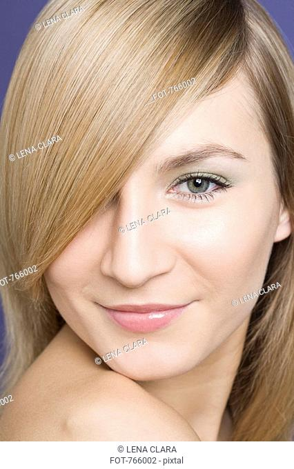 Headshot of a young woman with blond hair