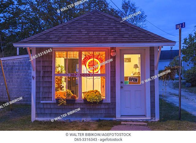 USA, Maine, Stonington, village hair styist shop, dusk