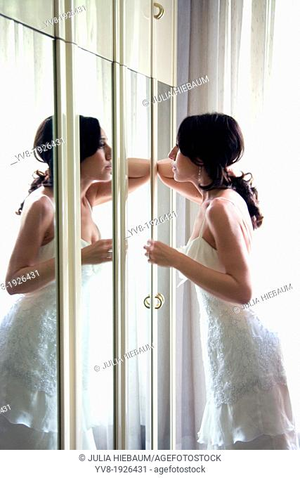Bride's image reflected in mirror