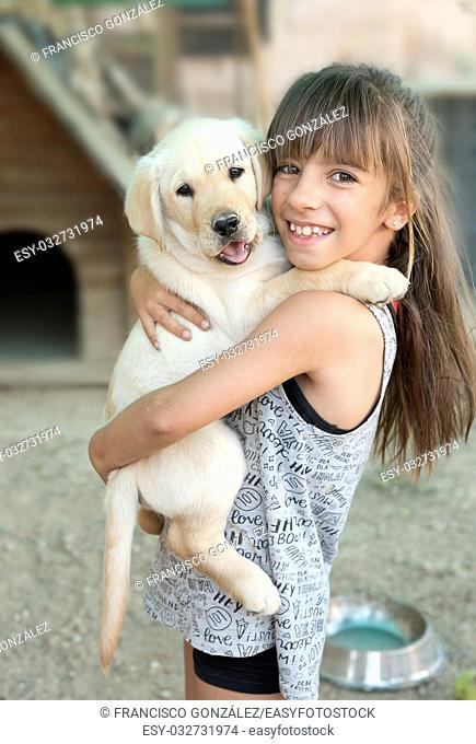 Portrait of 10 year old girl with a puppy golden retriever puppy