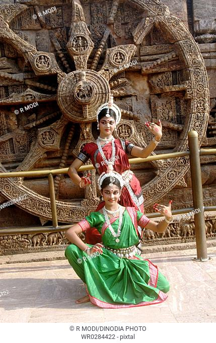 Dancers performing classical traditional odissi dance at Konarak Sun temple , Konarak , Orissa , India MR 736C,736D