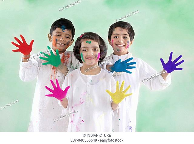 Children with coloured palms