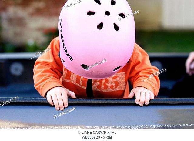 Toddler wearing bike helmet