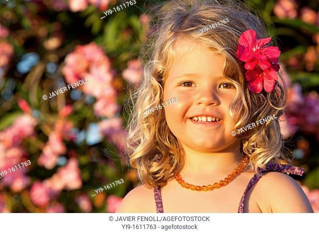 portrait of a beautiful girl with a flower in her hair