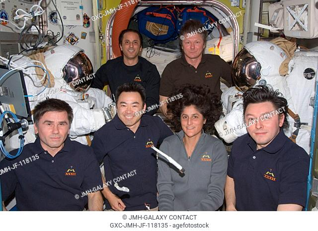 Expedition 32 crew members pose for an in-flight crew portrait in the Quest airlock of the International Space Station. Pictured from the left (front row) are...