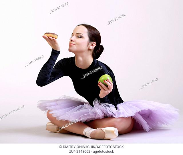 Ballerina posing with food