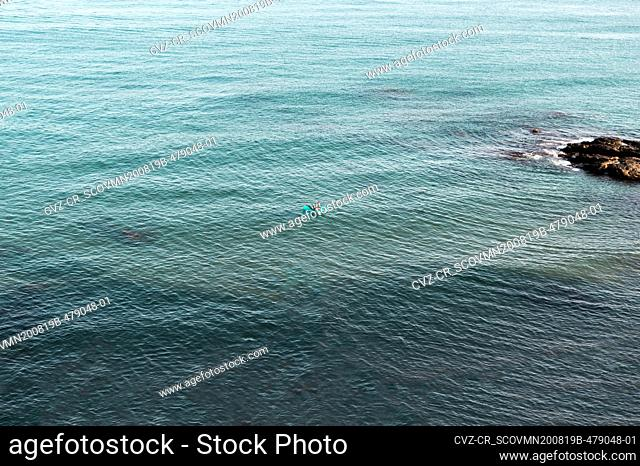 Lonely couple on a float in the middle of the sea on a summer day