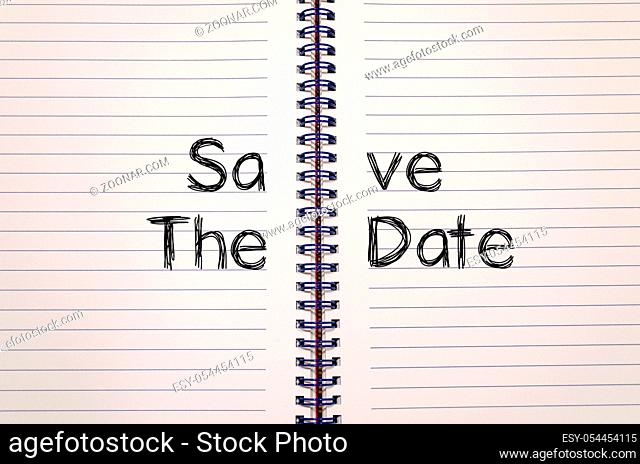 Save the date text concept write on notebook