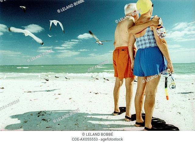 Senior Snorkelers Standing on Beach