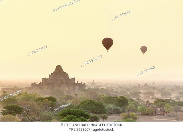 Hot air balloons floating over Bagan temples at sunrise, Bagan, Myanmar