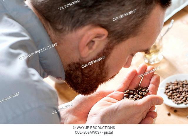 Coffee taster smelling coffee beans
