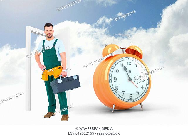 Composite image of smiling carpenter with toolbox