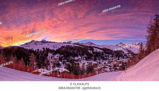 Panorama of the alpine village of Madesimo and snowy ski slopes at sunset Spluga Valley Valtellina Lombardy italy Europe