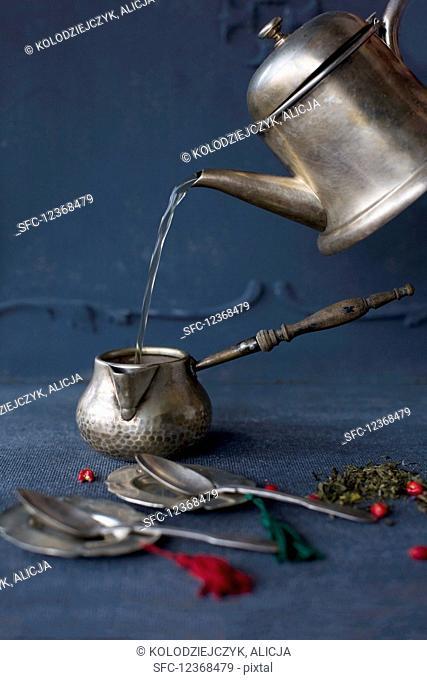 Tea making in silver jug