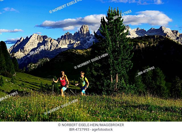 Hikers on the ascent from the Prato Piazza to the summit of the Dürrenstein, in the back the summit of Monte Cristallo, Sexten Dolomites, Alta Pusteria