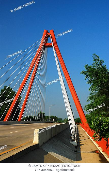 The red, modern Second Avenue Bridge is the main thoroughfare into Columbus, Indiana