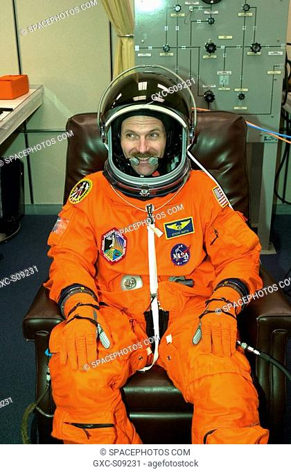 03/18/2002 -- STS-110 Mission Specialist Steven Smith relaxes during suit fit, which is part of Terminal Countdown Demonstration Test activities
