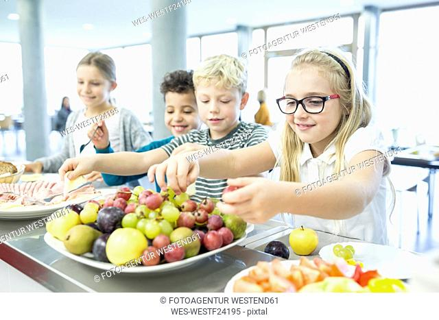 Pupils at counter in school canteen